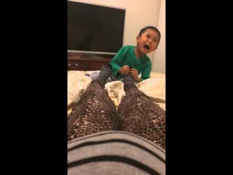 Troy massaging mummy's feet
