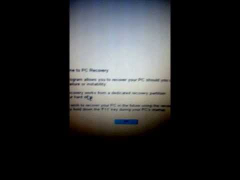 How to restore a compaq Presario f700 laptop running Windows XP to factory settings