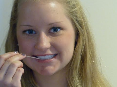 Cleaning teeth with a toothpick,  Dr. Dennis J. White