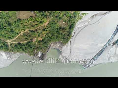 Brahmaputra descends into plains of India, through rain forests and tribal villages