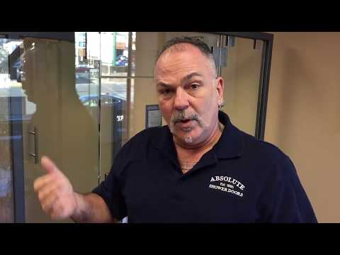 Chris from Absolute Shower Doors discusses frameless shower doors clips vs channels