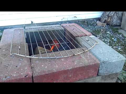 Rocket stove with bricks double grills