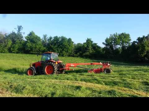 Cutting hay with Kubota M135GX