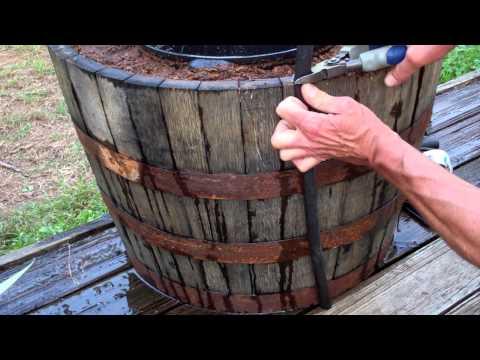 Cut half inch hose to barrel height