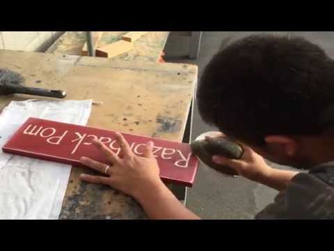 How To Make a Rustic Spray Painted Custom Wood Sign