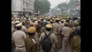 Delhi Police stage protest demanding action against lawyers who attacked them