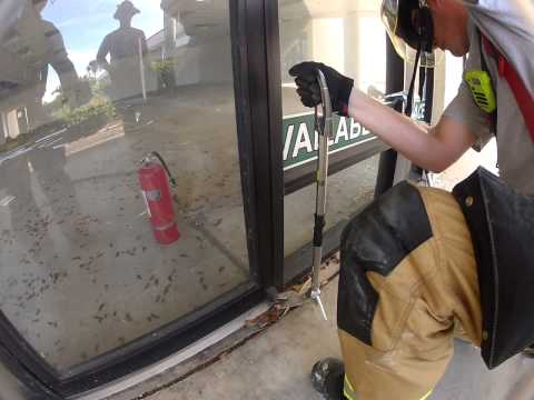 Storefront door removal from pin hinge