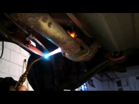 Using a Torch to Remove a Rusty Muffler Part 1 - EricTheCarGuy