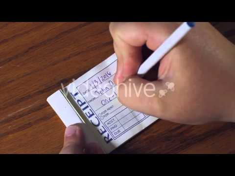 Receipt Book [STOCK FOOTAGE]