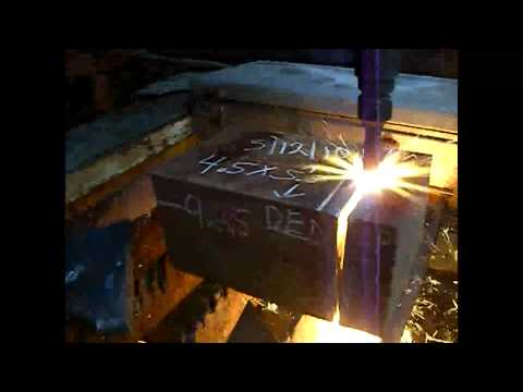 Flame cutting  thick steel with an oxy-fuel torch.