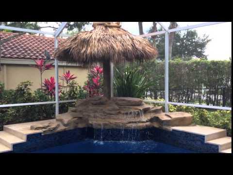 Waterfall with tiki umbrella