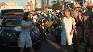 Shasta Darlington and Arwa Damon run with Olympic torch