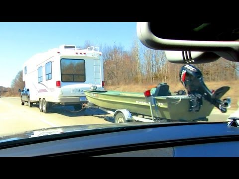 This is awesome - double trailer towing, make your own roadtrain! (Truck pulling camper and boat)