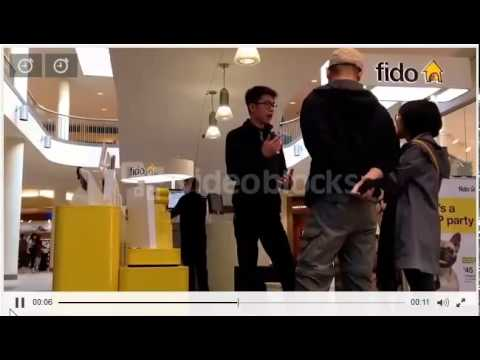 People asking fido sales clerk about cellphone plan inside the shopping mall  Stock Video Footage 2