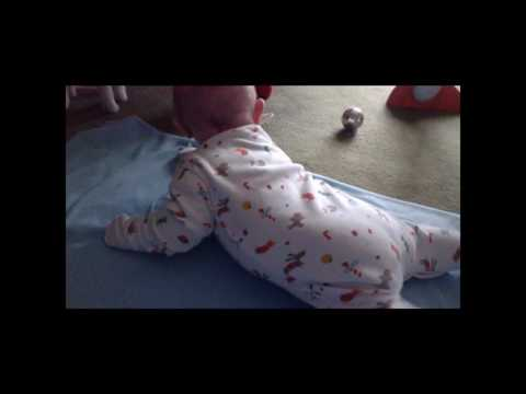 Baby George is learning to roll over and crawl -