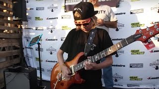 Download 12-Year-Old Kid Destroys Opponents in Guitar Shred-Off Video