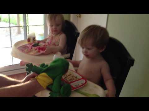 Toddler twins eat dinner......