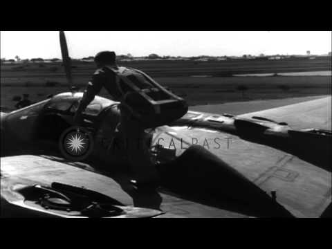 Pilot checks recently assembled P-38 plane on field in Australia. HD Stock Footage