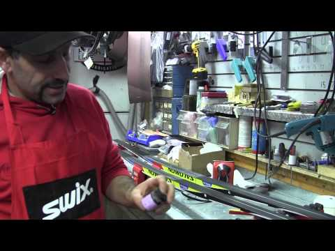 McBike demonstrates how to apply grip wax to XC skis