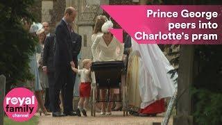 Prince George peers into baby sister