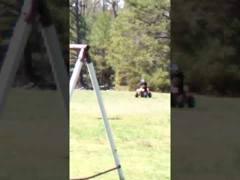 Lil couz Trying to get it on the 4Wheeler