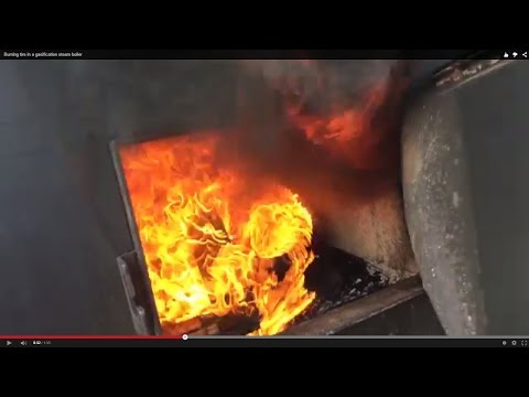 Burning tire in a gasification steam boiler