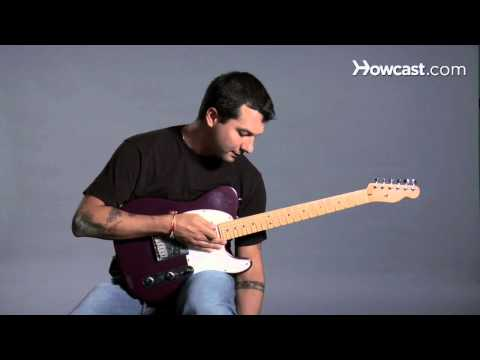 How to Hold a Guitar While Sitting | Guitar Lessons