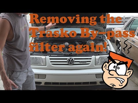 Removing the Trasko bypass oil filter again and install Amsoil Series 3000 5w-30