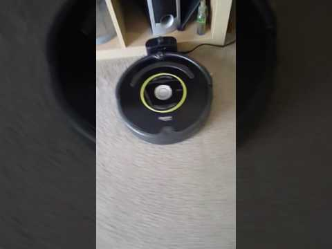 Irobot Roomba 650 charging with a clean floor.