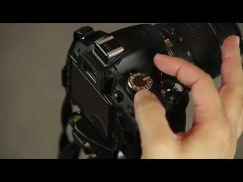 How to select the exposure mode on the Nikon D3200