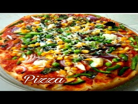 How to make pizza in oven recipe in Hindi.