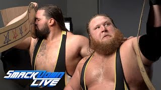 Heavy Machinery pose with the Yolo County Tag Team Titles:SmackDown Exclusive, June 11, 2019
