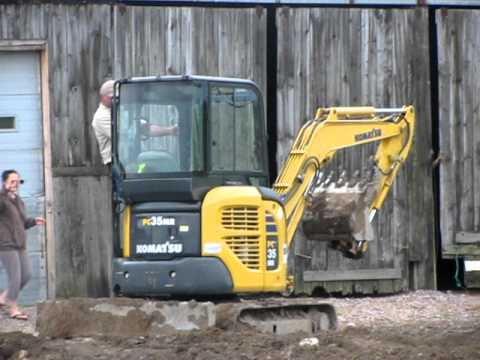 2yr old learning to drive mini-excavator on farm (part 2)