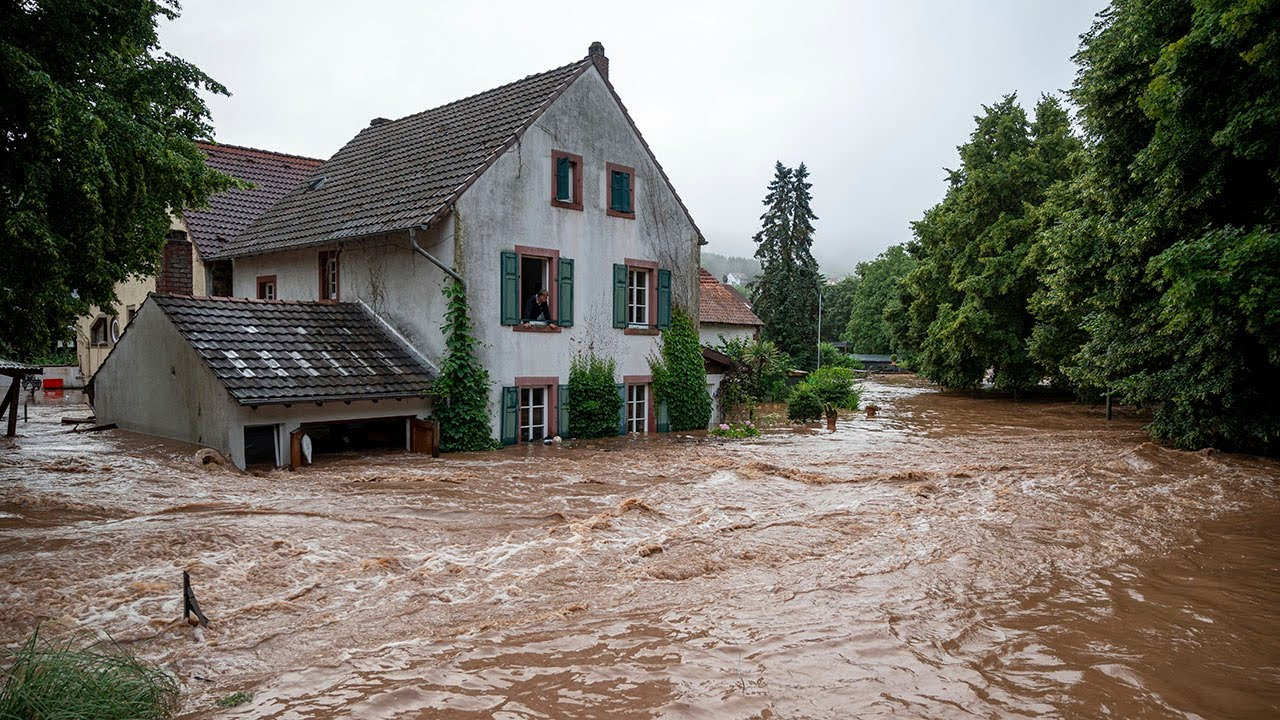 Apocalyptic waters wash away cars and cause landslides as freak floods ravage Europe