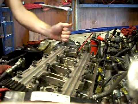 (1of8) Taking the head off a JDM H22a to replace the head gasket and valves in a civic hatchback.