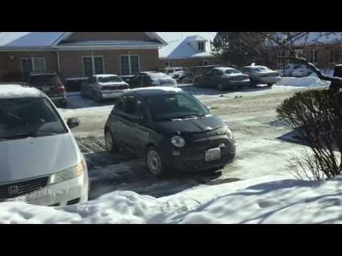 The Fiat 500 handles snow on roads in a suburban winter just fine