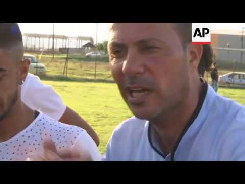Migrants face Greek locals in football tournament