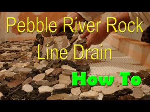 How to install pebble tile with a line drain.