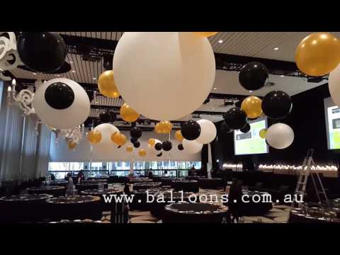 GIant cloudubster ceiling installation - Balloons Online Decor Video Tour