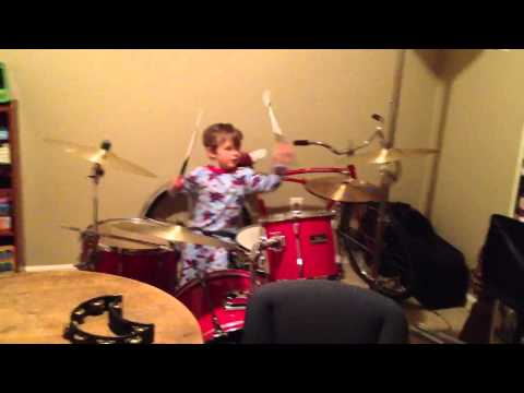 Charlie's first time on a drum set