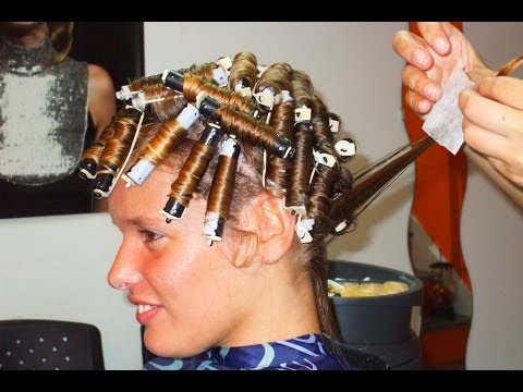Nice woman with natural straight hair getting a soft roller perm