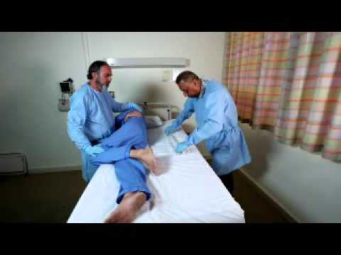 How to change a 90cm x 60cm TouchDRY by rolling patient with no slide sheets