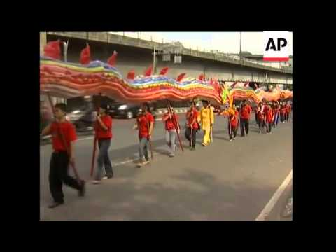 School children make Chinese dragon from used plastic bottles