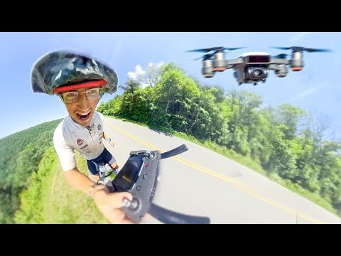 I BOUGHT A DRONE! - Flying DJI Spark WHILE cycling!