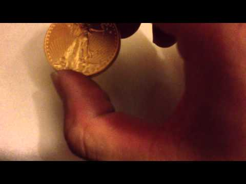 Weighing a 1 Ounce Gold American Eagle Bullion Coin