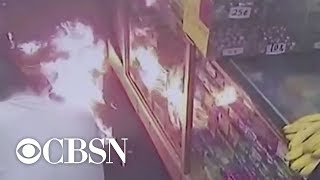 Man lights up fire in front of NYC deli