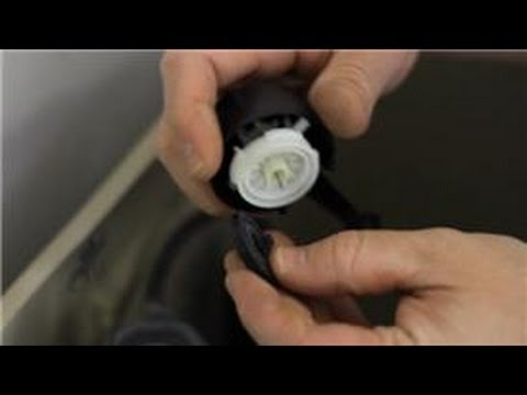 Toilet Repair Tips : How to Fix the Refill Valve for a Toilet Tank