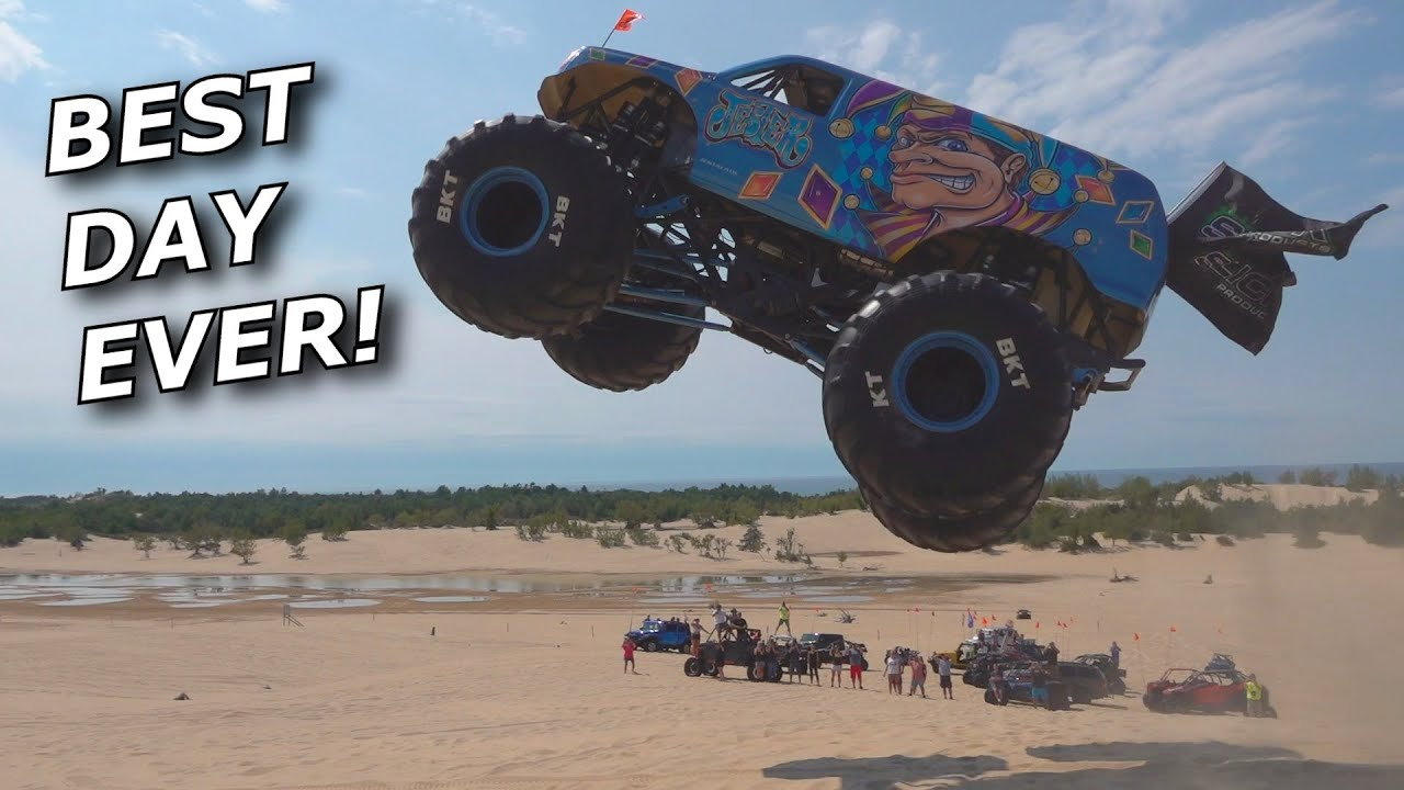 WE DRIVE MONSTER TRUCKS! Biggest dune jump ever? INSANE!