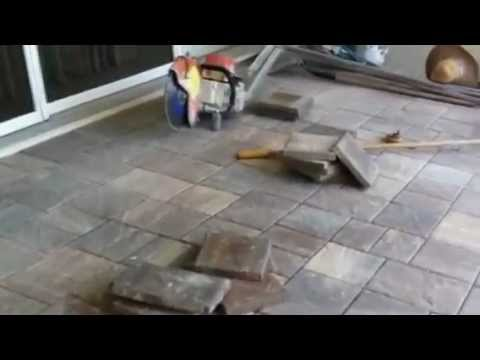 Laying pavers on a pool deck