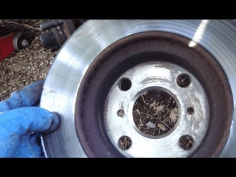 How to change brake disc front Toyota Corolla